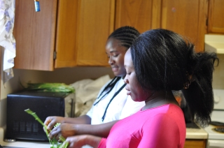 Jenna and Secret remove potato leaves from central stem