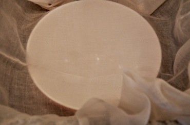 Drape cheesecloth over a bowl or strainer